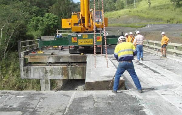 Bridge decks being removed after being cut
