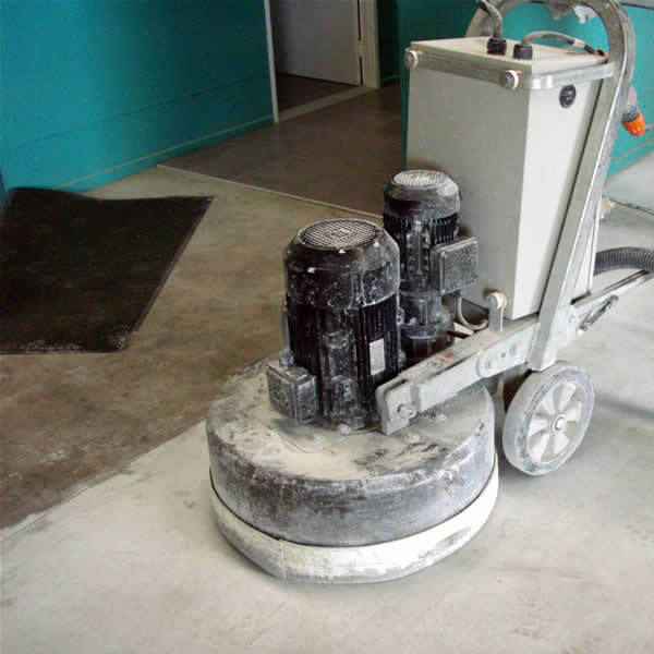 Grinding floor in preparation for laying tiles